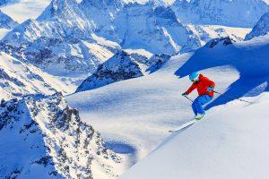 Skier_male_glaciers_red_jacket